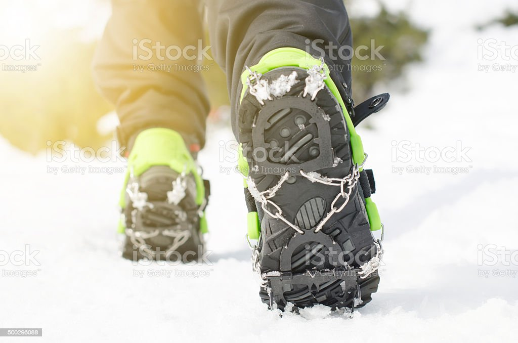 Hiking boots with equipment for ice. Snow like a background stock photo