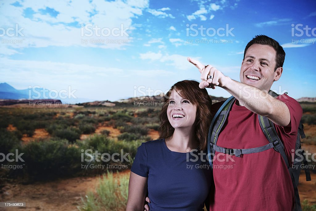 Hiking couple in an arid field stock photo