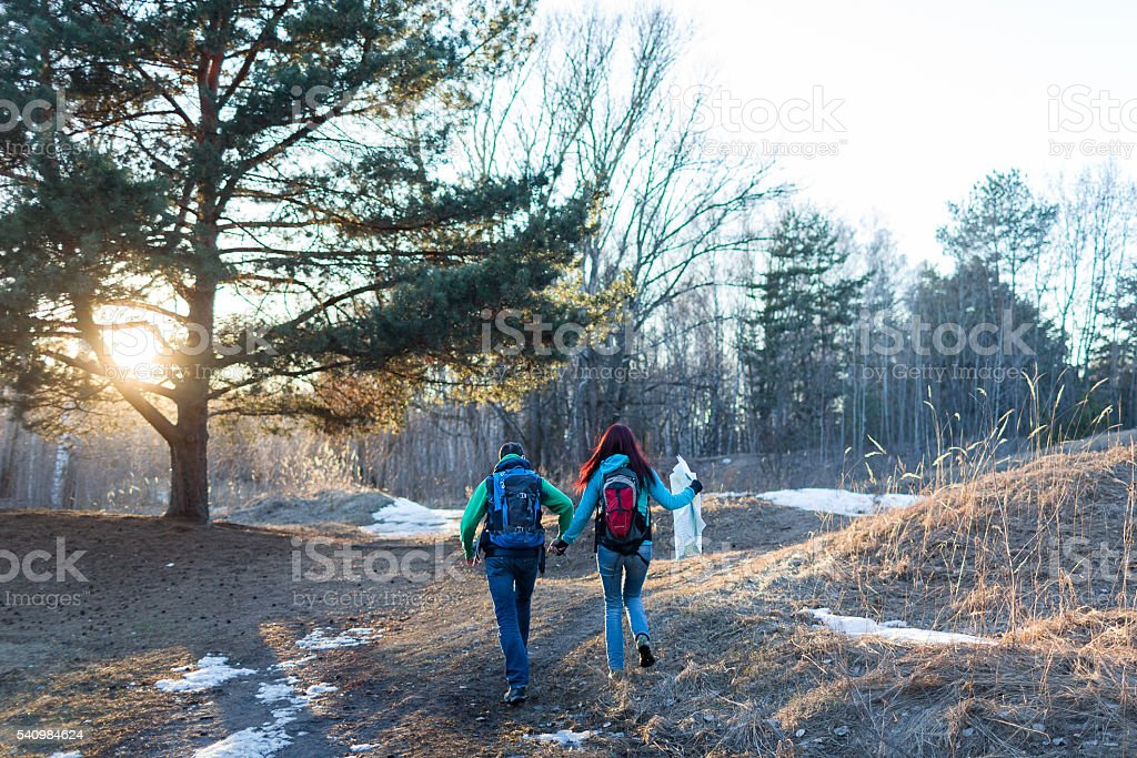 Hiking couple in spring forest. stock photo
