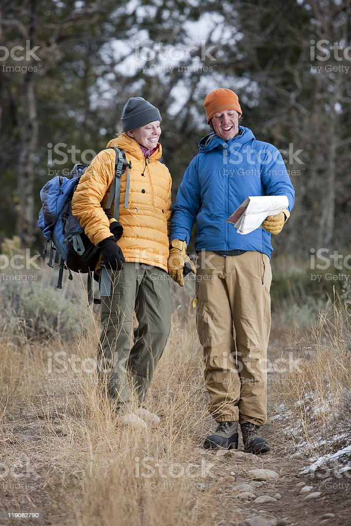 Hiking Couple Looking at Map Together stock photo
