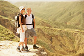 Hiking Couple Standing On Top Of Mountain