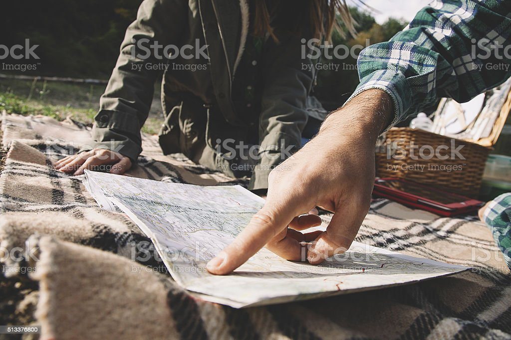 Hiking couple with map in mountain stock photo