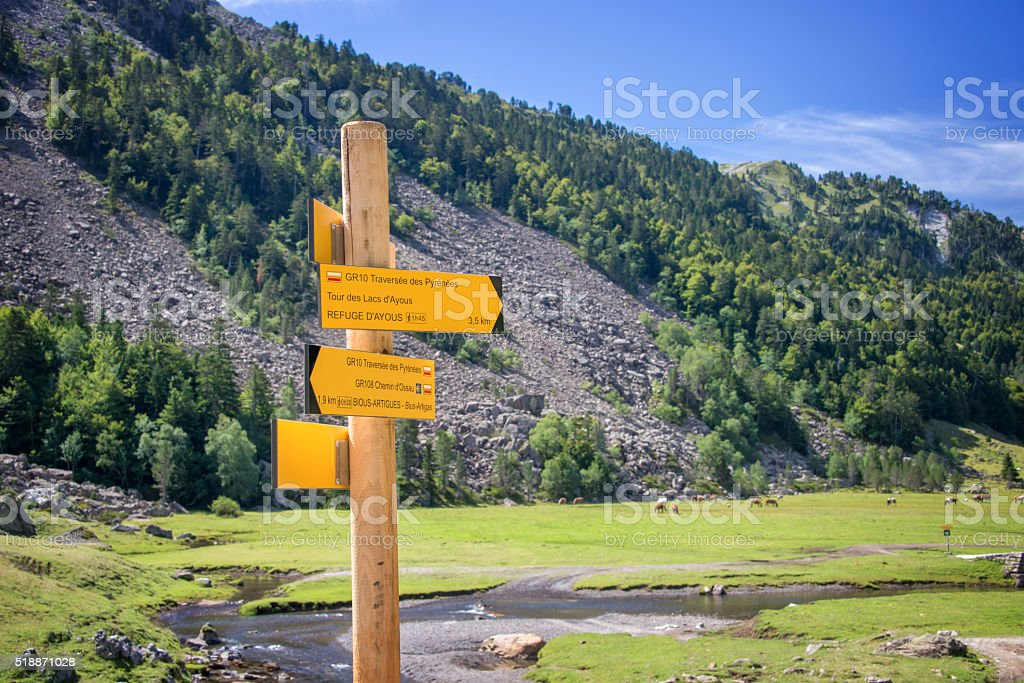 Hiking direction sign in Ossau Valley, Pyrenees, France stock photo
