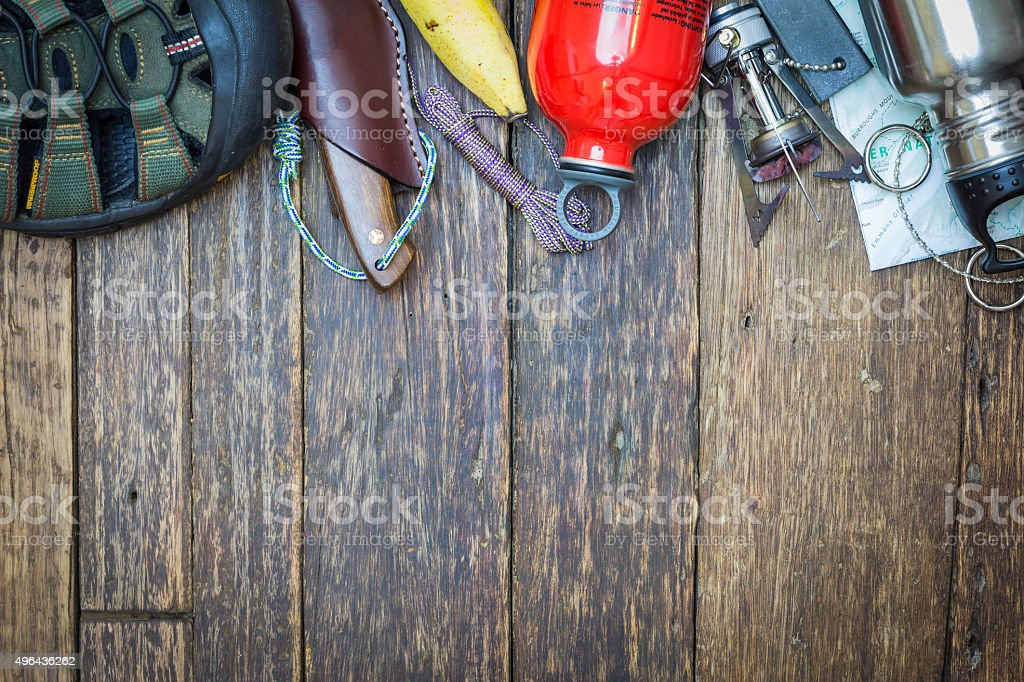 Hiking Equipment on a wooden floor background stock photo