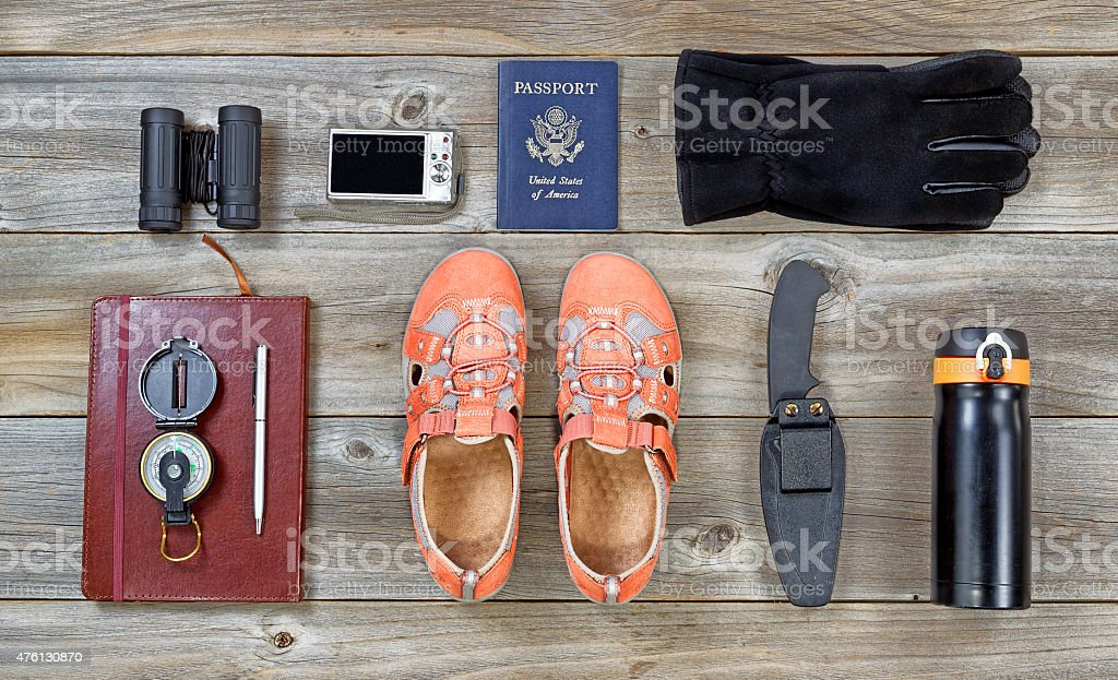 Hiking Equipment on rustic wood stock photo