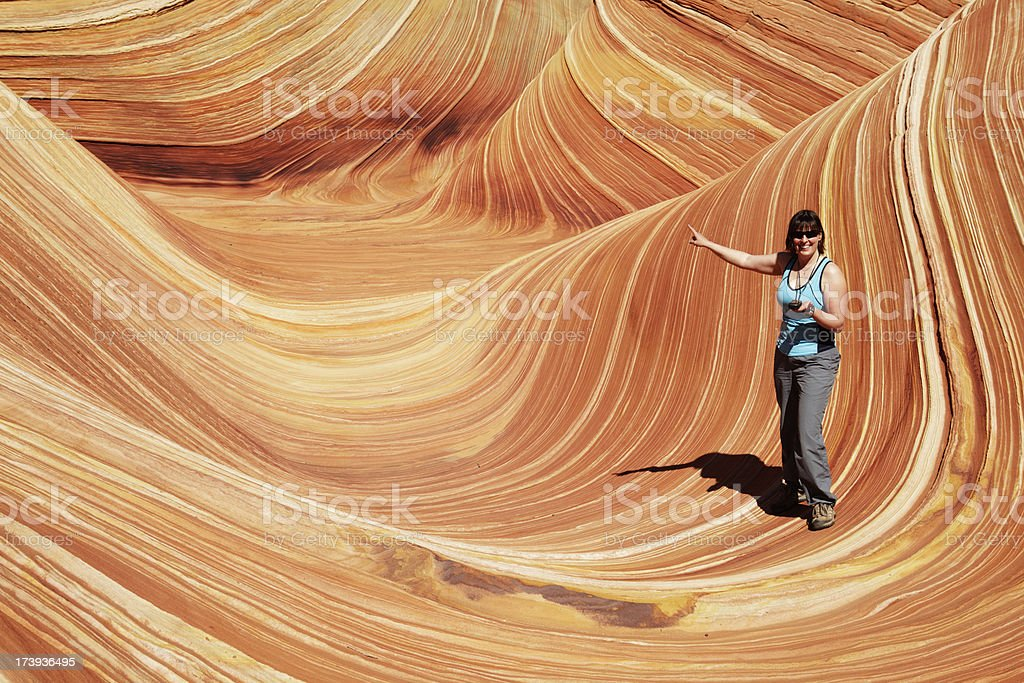 Hiking girl with GPS pointing at the Wave royalty-free stock photo