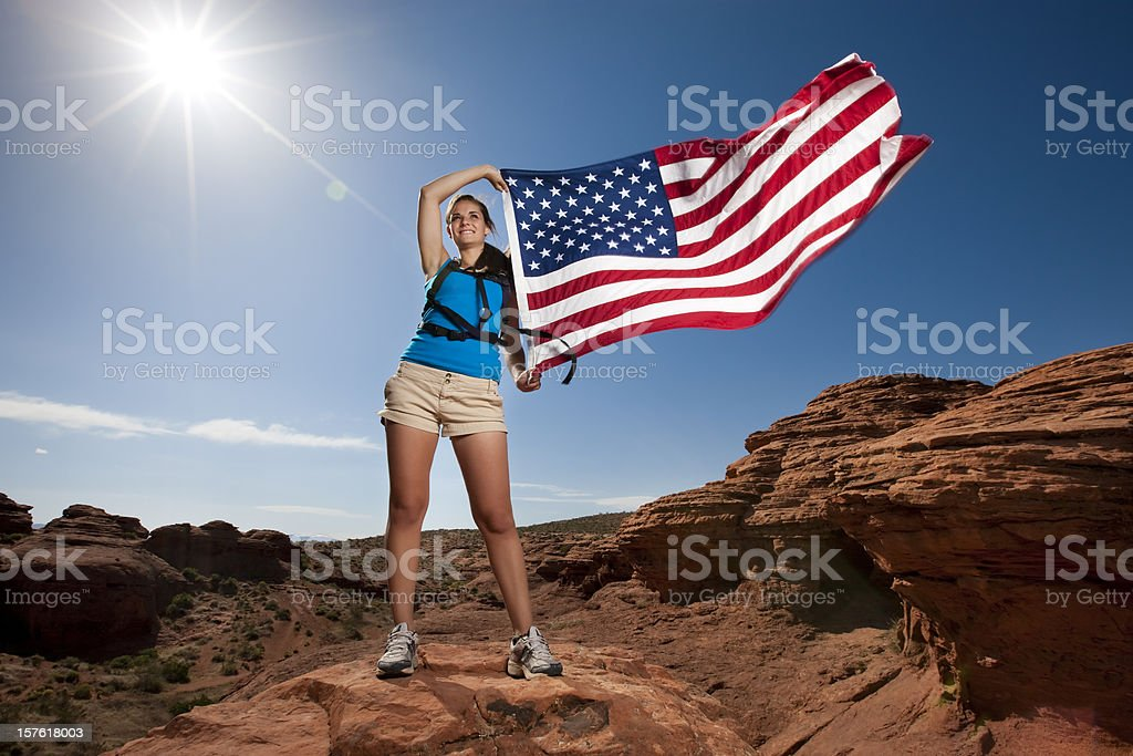 Hiking Girl with US Flag royalty-free stock photo