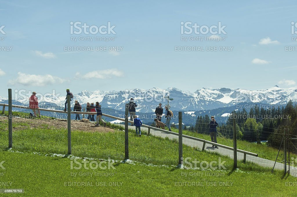 Hiking group at Pfander with view to Bregenzerwald stock photo