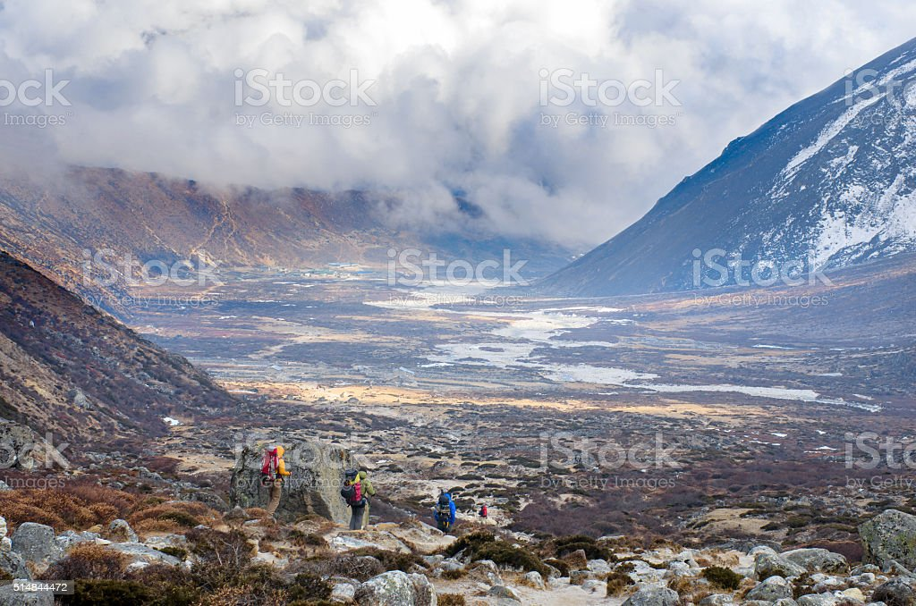 Hiking group on a trail.  Nepal, Himalayas stock photo