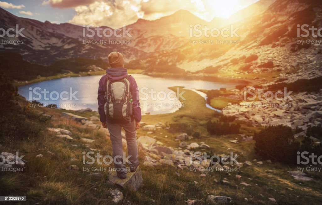 Hiking in mountains and enjoying a view from above stock photo
