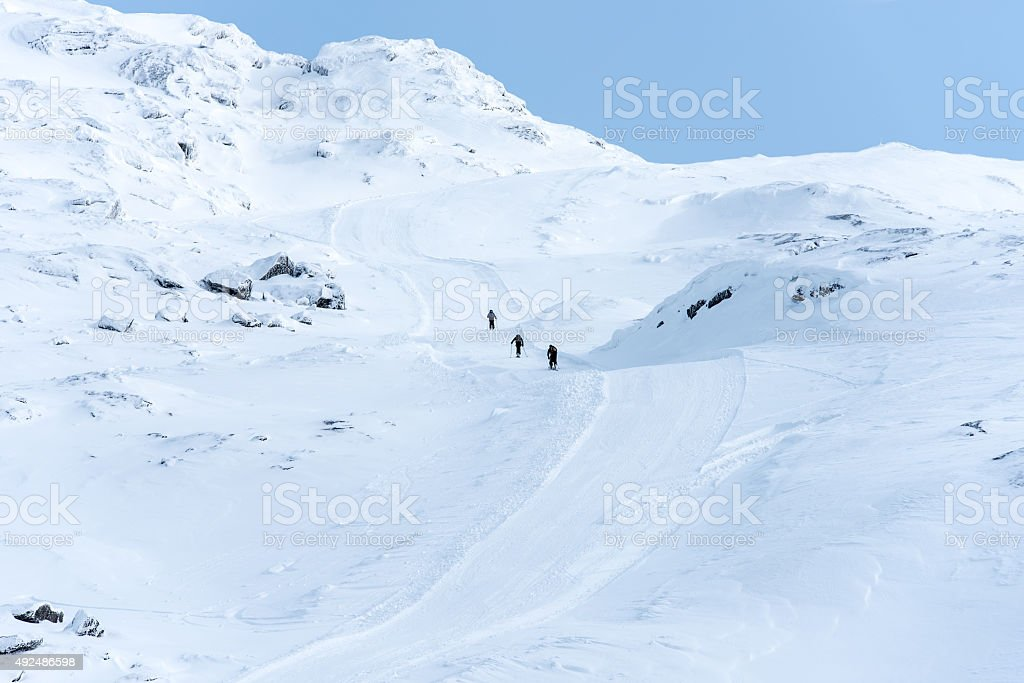 Hiking in snow stock photo