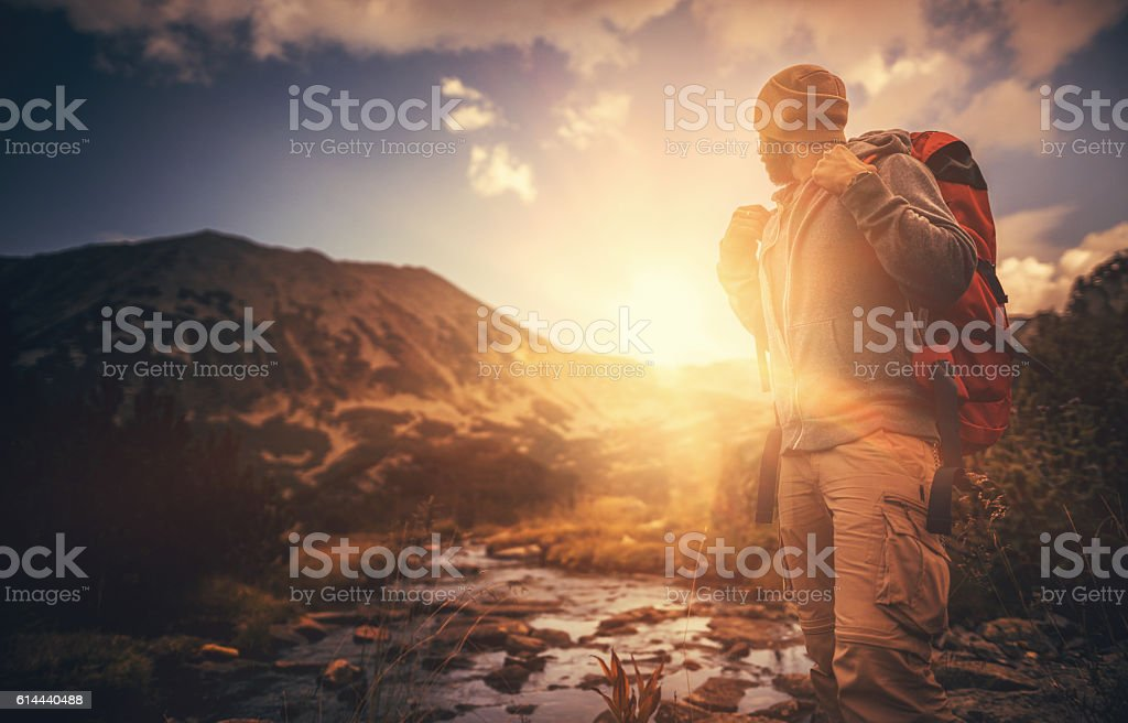 Hiking in solitude at sunset stock photo