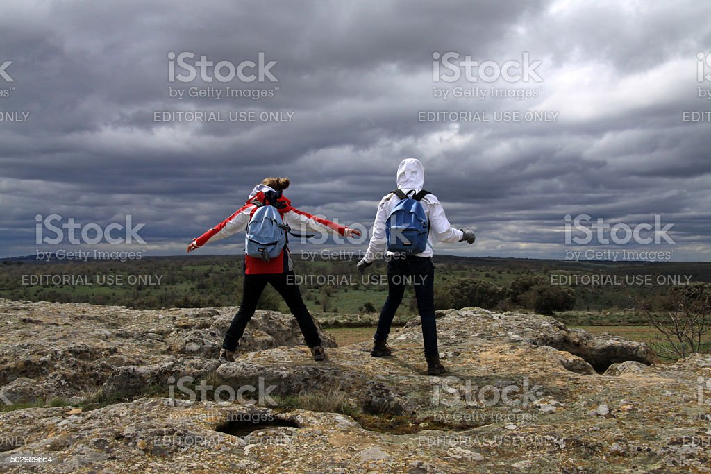 Hiking in stormy wheather in Spain stock photo