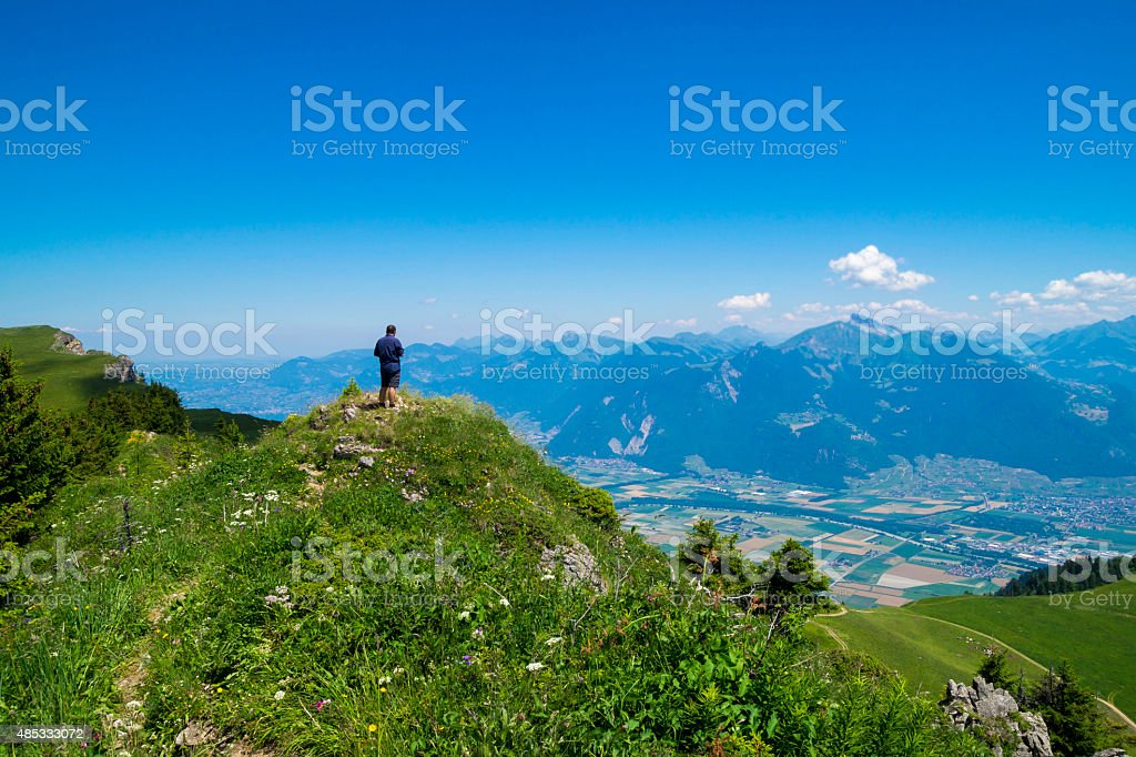 Hiking in the Alps Mountains stock photo