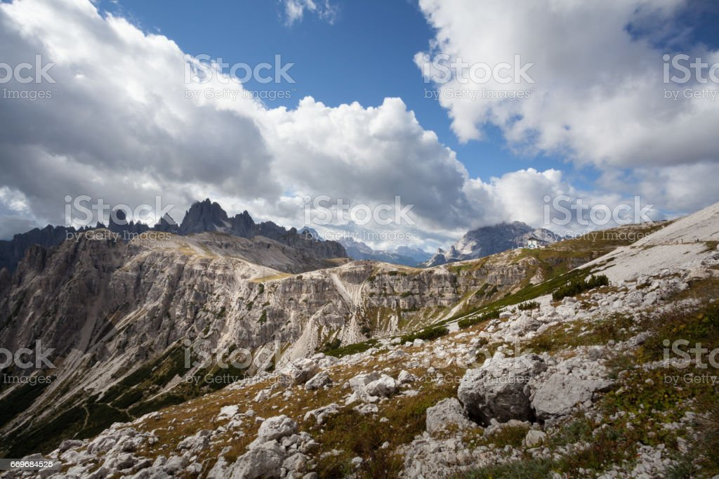 Hiking in the Dolomites with light and shadows stock photo