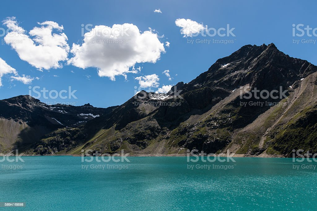 Hiking in the lake covered mountains of Tyrol Austria stock photo