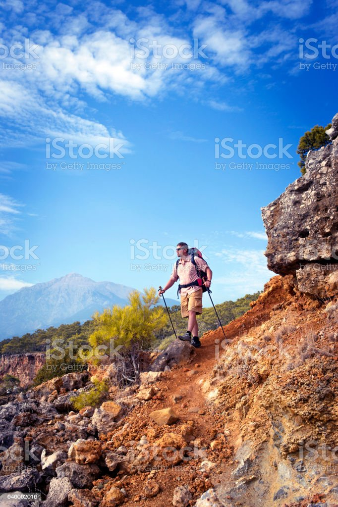 Hiking in the mountains in the summer on a sunny day. stock photo