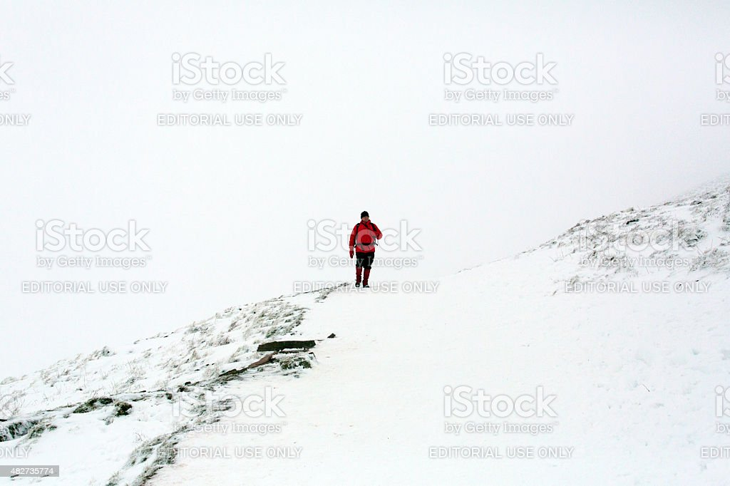 Hiking in the snow stock photo