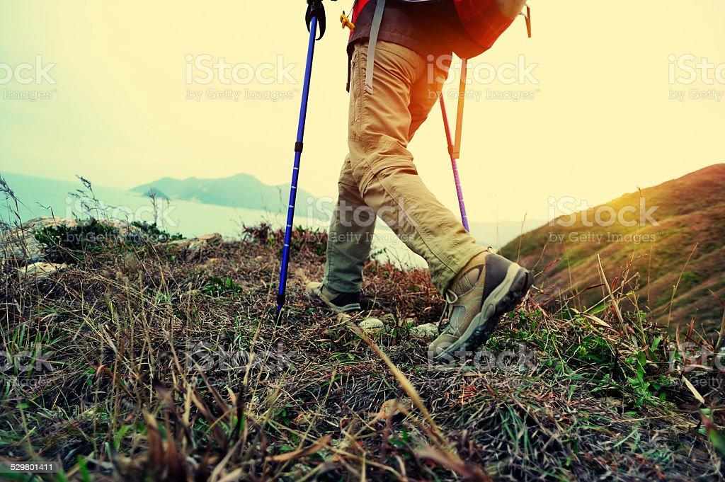 hiking legs seaside mountain peak stock photo