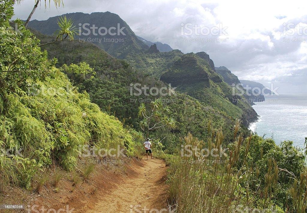 Hiking Na Pali Coast in Kauai, Hawaii. stock photo