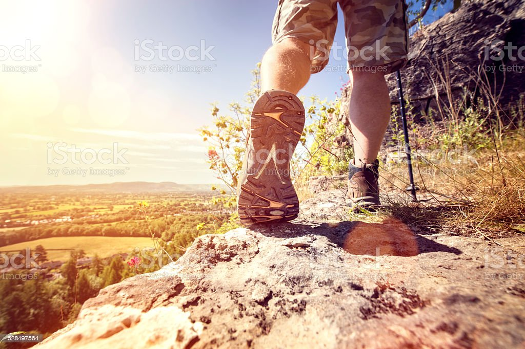 Hiking on a mountain trail stock photo