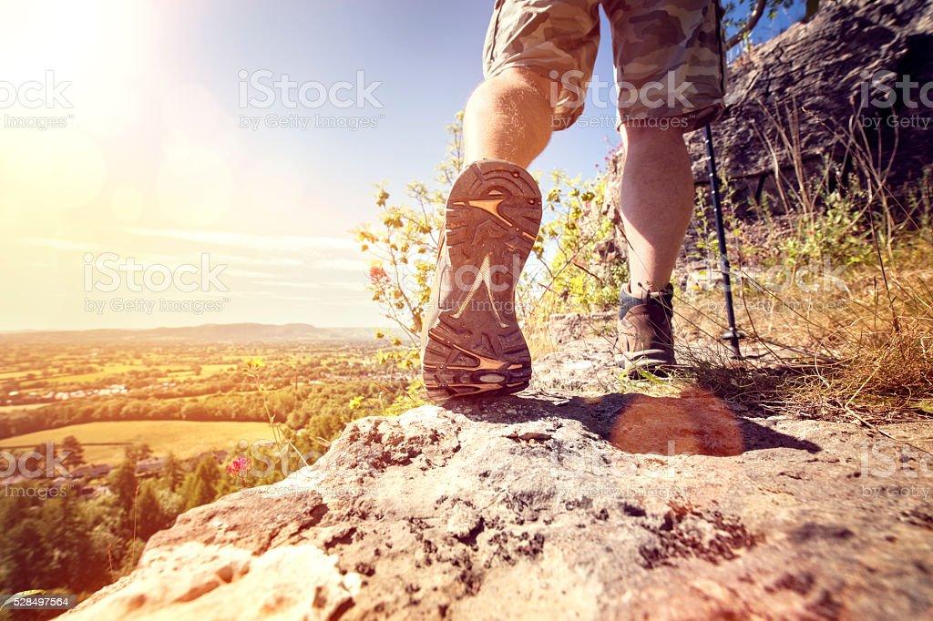 Hiking on a mountain trail stock photo