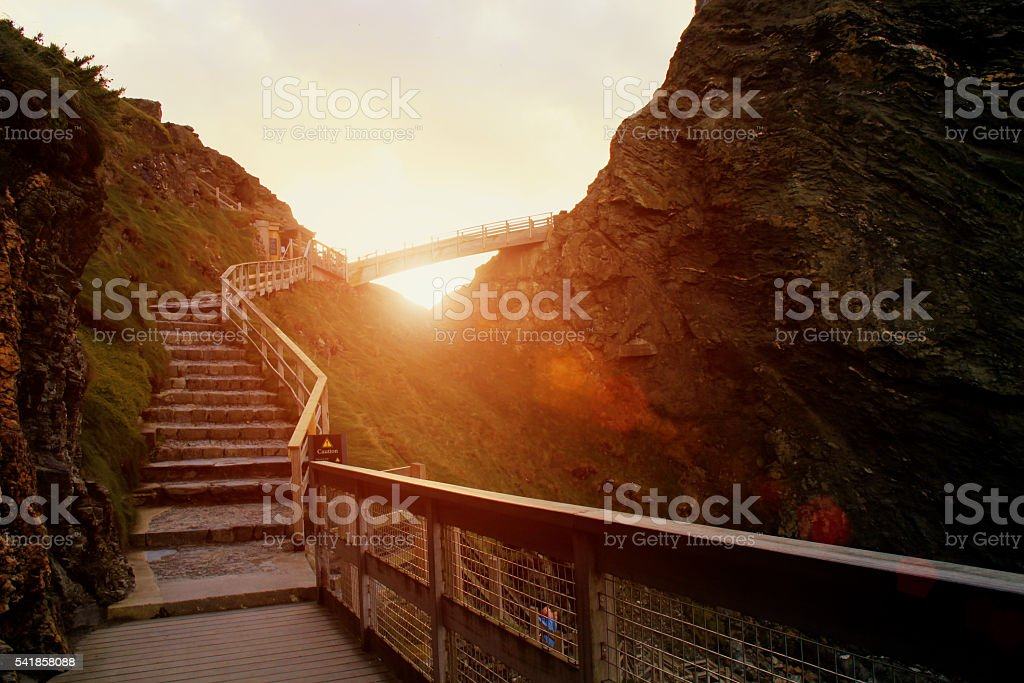 Hiking on the cliffs of Cornwall at sunset stock photo