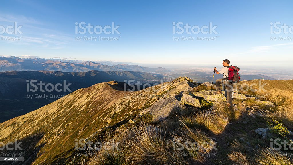 Hiking on the mountain ridge on the Alps stock photo