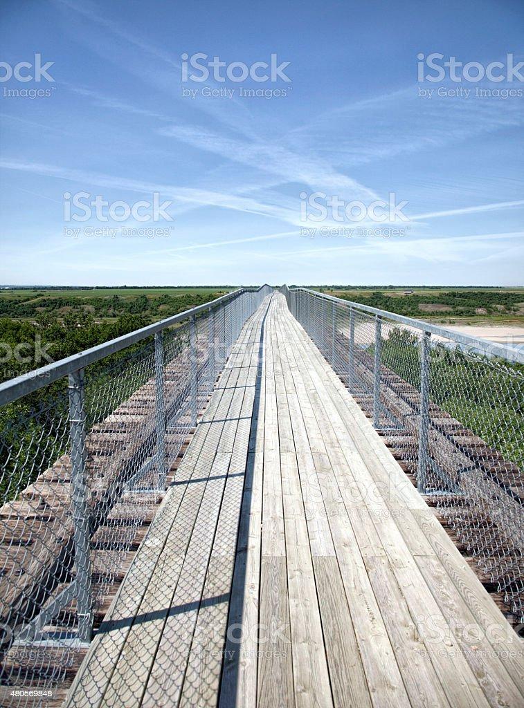 Hiking Path Over Trestle Bridge at Outlook Saskatchewan stock photo