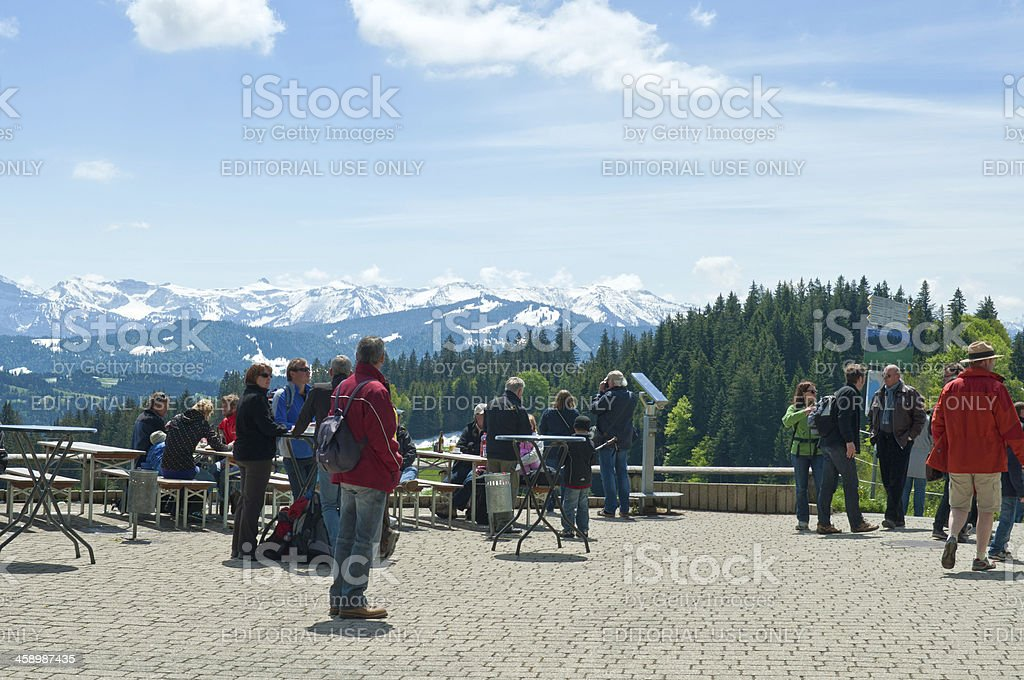 Hiking people resting at Pfander with view to Bregenzerwald stock photo