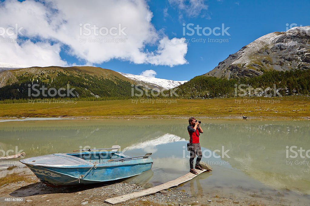 Hiking photographer taking pictures stock photo