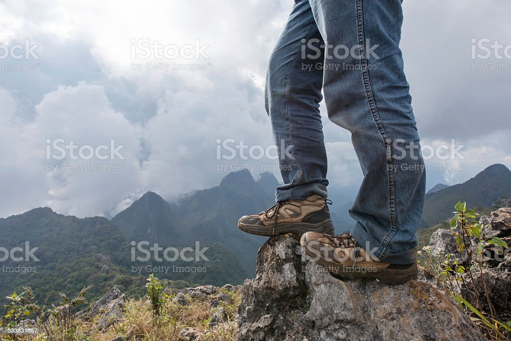 Hiking shoes on the summit stock photo
