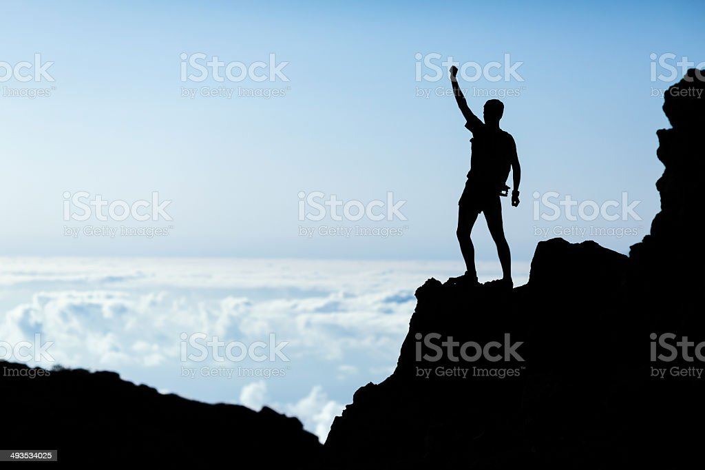 Hiking success silhouette, man trail runner in mountains stock photo