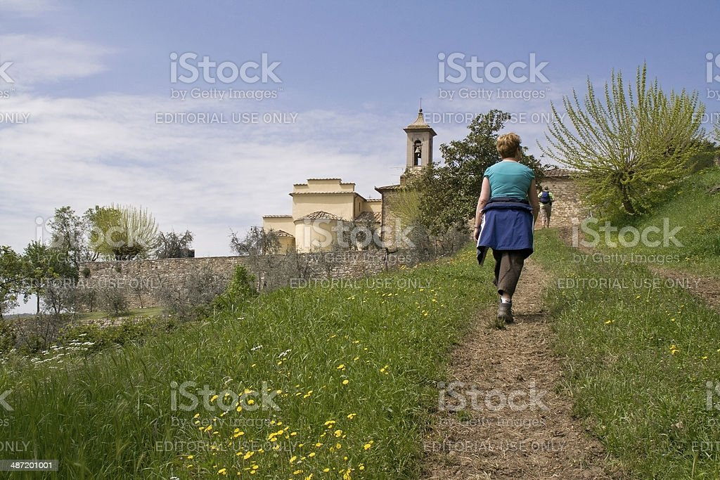 Hiking to a countryside church in Tuscany, Italy. stock photo