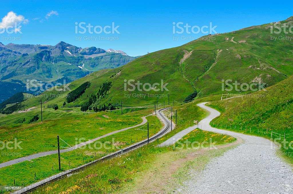 Hiking Track and Railway in Swiss Mountains Region royalty-free stock photo
