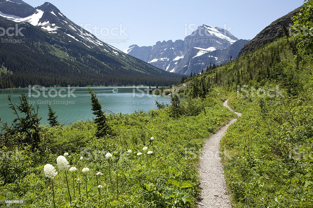 Hiking trail and boat in Lake Josephine Glacier National Park stock photo