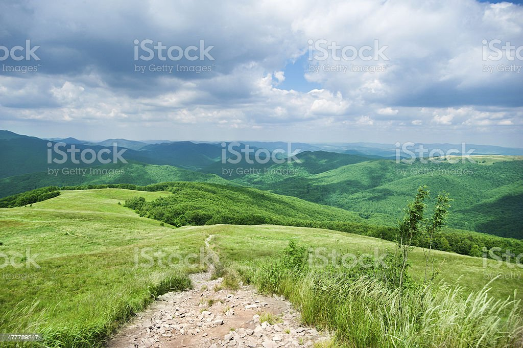 Hiking trail in mountains landscape royalty-free stock photo