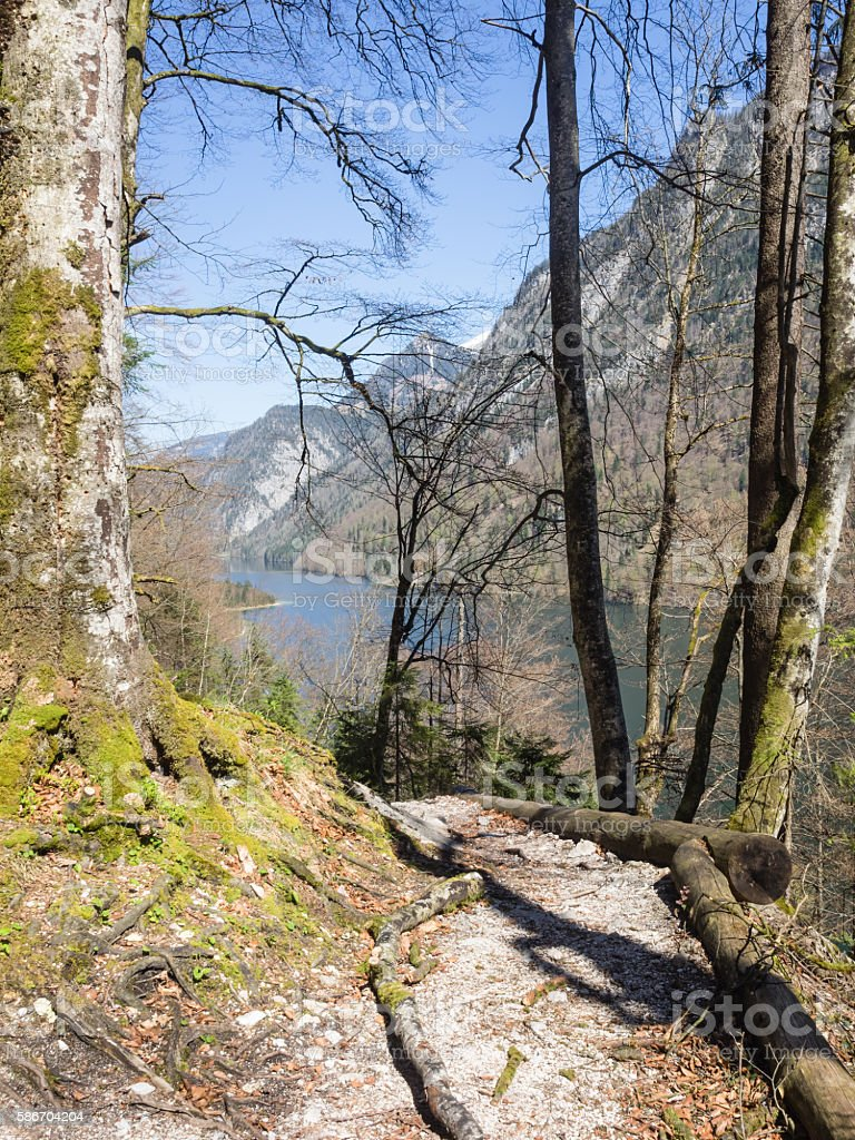 Hiking trail in the Bavarian Alps with lake Koenigssee in the background stock photo