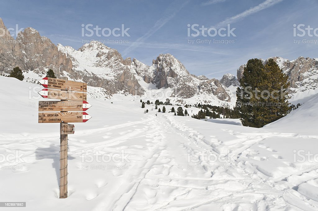 Hiking Trail in the Winter Scenario of Puez-Odle Park stock photo