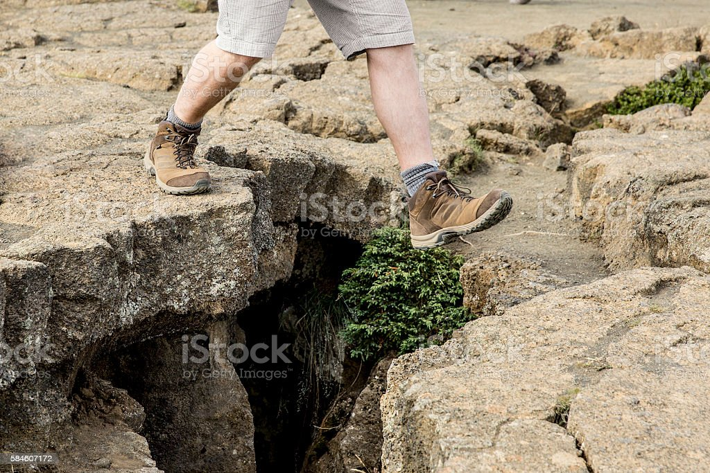 Hiking Trail Jumping Over a Crevasse stock photo