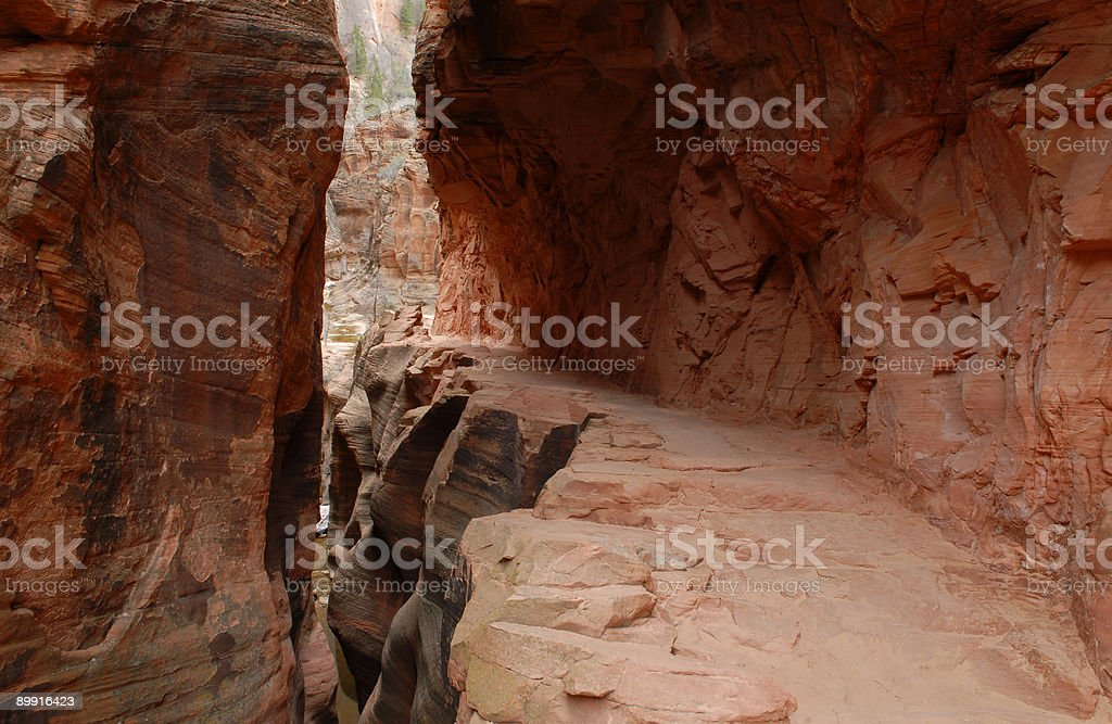 Hiking trail through a slot canyon in Zion National Park royalty-free stock photo