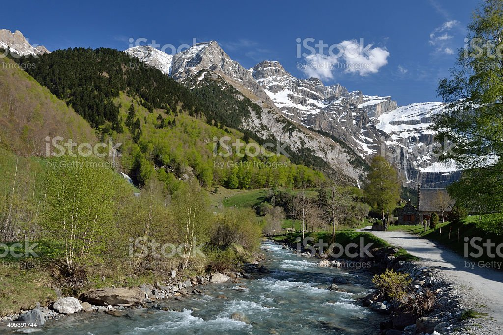 Hiking trail to the cirque of Gavarnie in Pyrenees stock photo