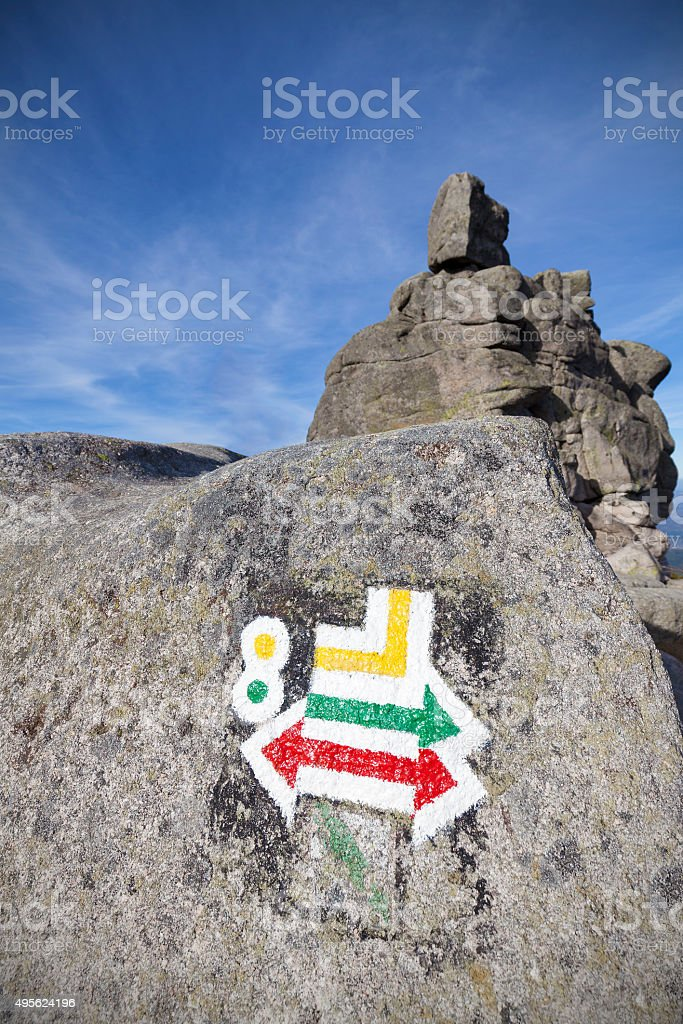 Hiking trails signs painted on rock, shallow depth of field stock photo