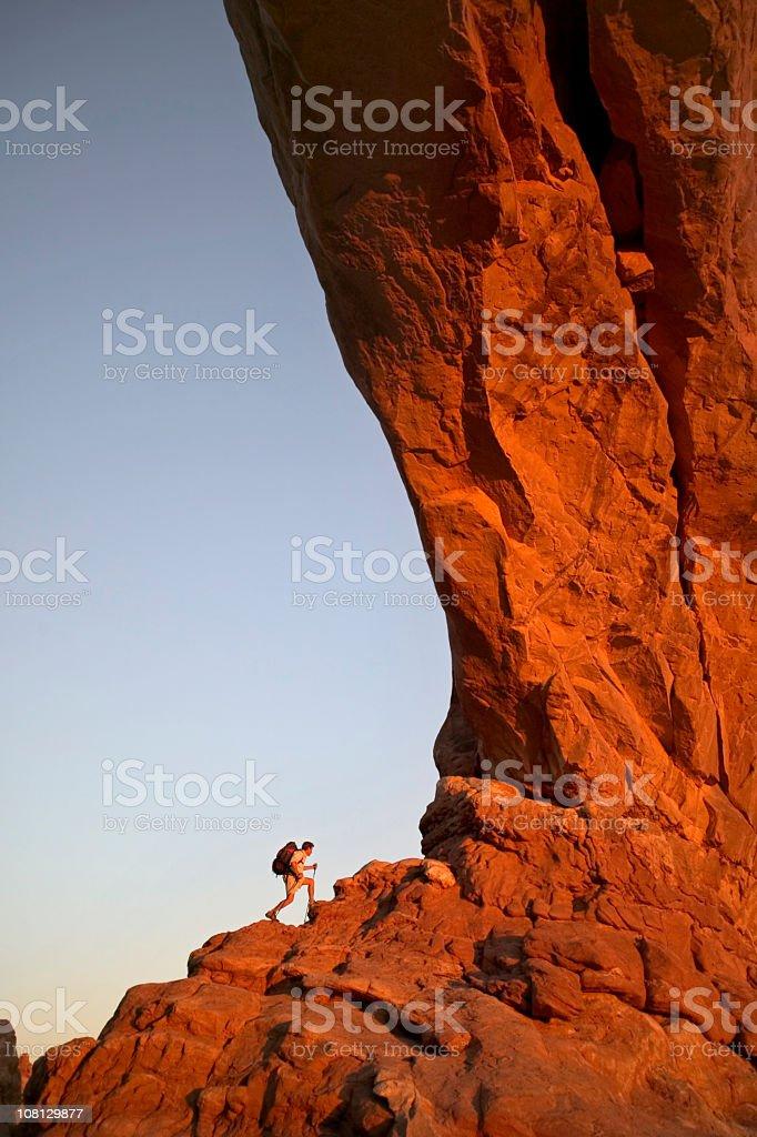 Hiking Traversing Massive Rock Ledge stock photo