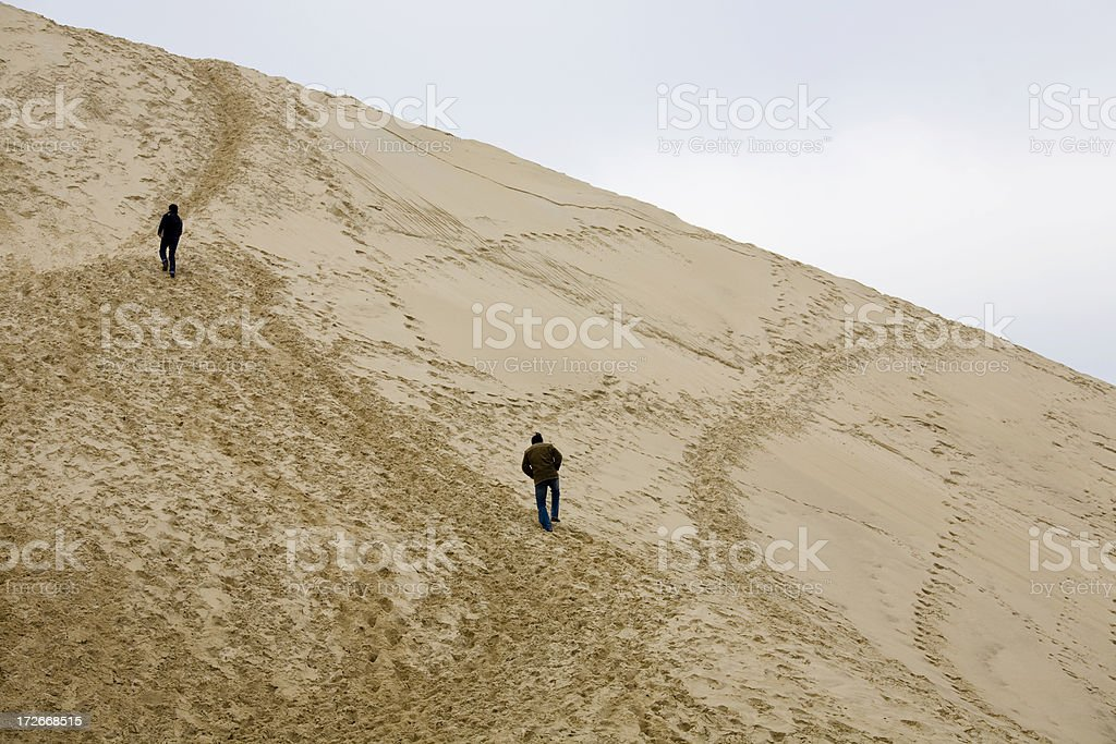 'Hiking up the Dune of Pilat, France' stock photo