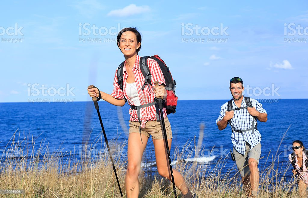 Hiking with backpack in the forest stock photo