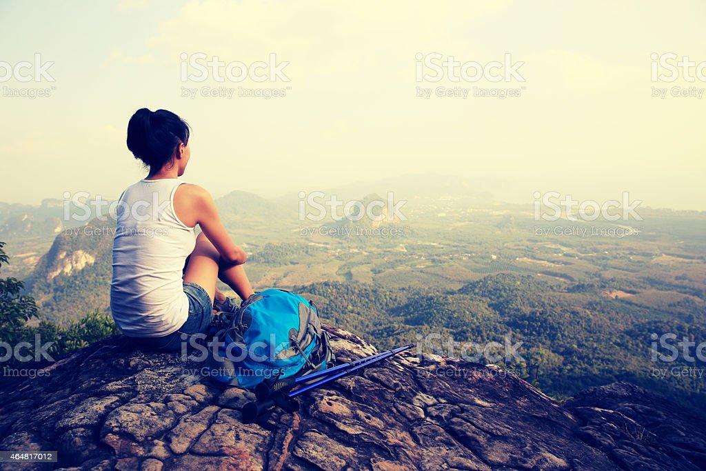 hiking woman enjoy the view on mountain peak stock photo