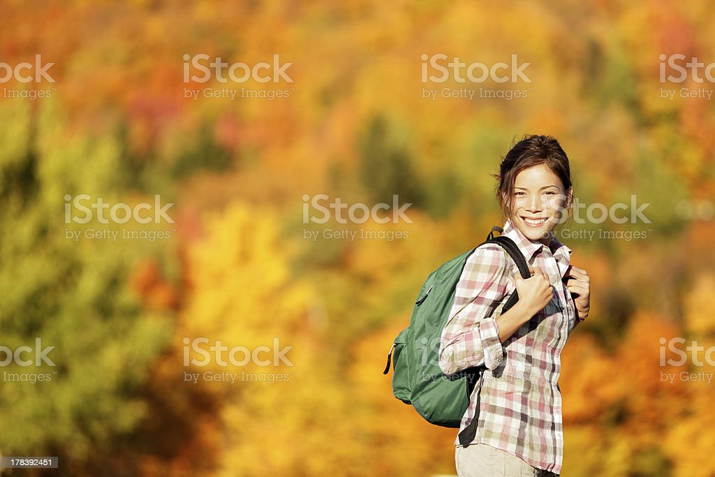 Hiking woman in Fall forest royalty-free stock photo