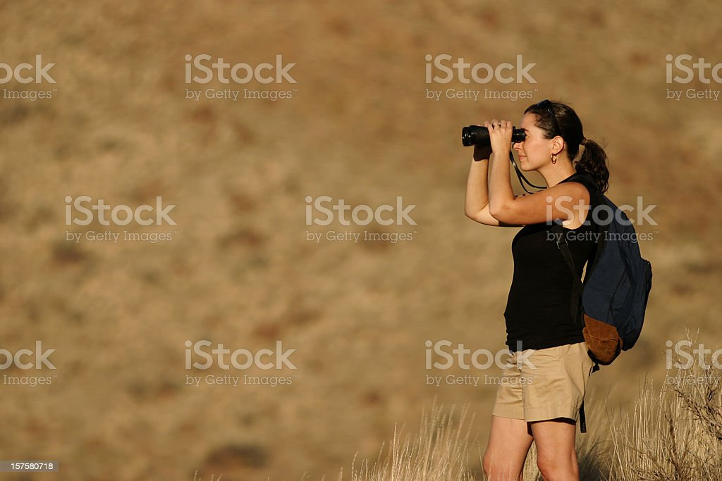 Hiking Woman Looking Through Binoculars royalty-free stock photo