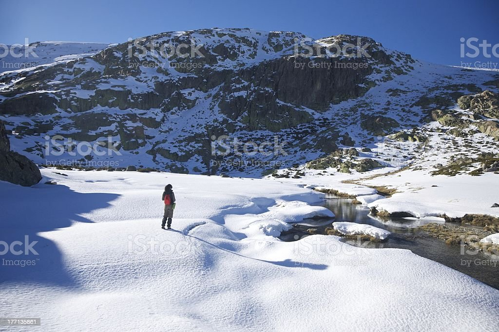 hiking woman on snow valley royalty-free stock photo